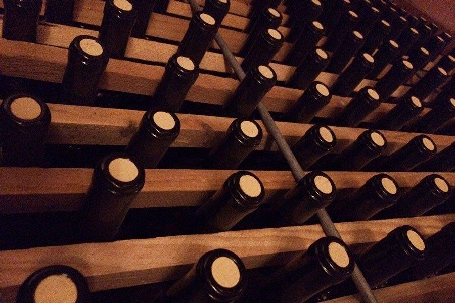 trigiro_tours_reason_visit_naoussa_wine-region_cellar-bottles